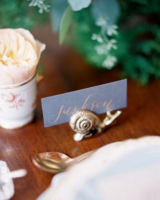 eclectic snail figurine place card holder