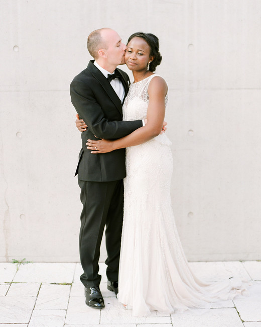 anwuli patrick wedding couple hugging in front of cream wall