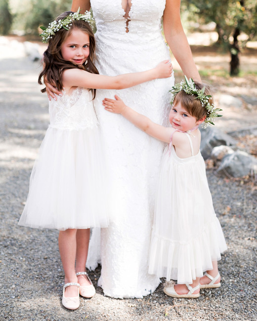 two flower girls in tulle dresses with flower crowns