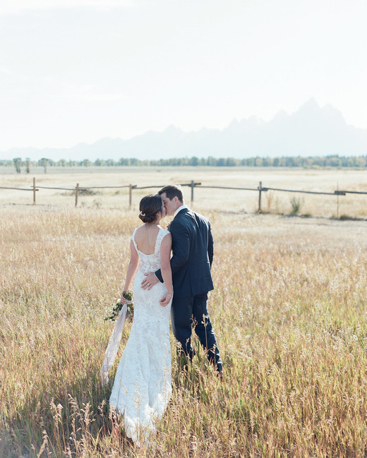 bride and groom kissing outside at jackson hole