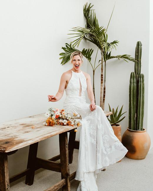 lisa sam mexico wedding bride sitting on wooden table