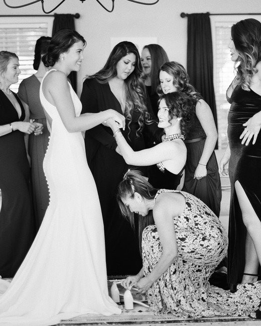 bride with friends getting ready for wedding