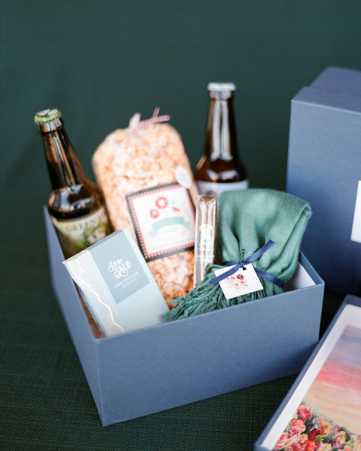 Asheville beers, jalapeno popcorn, chocolate bars, and chocolate chip cookies filled welcome boxes