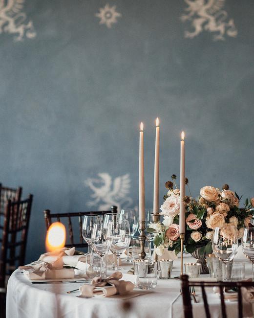 natalie paul wedding ornately decorated table against slate blue wall