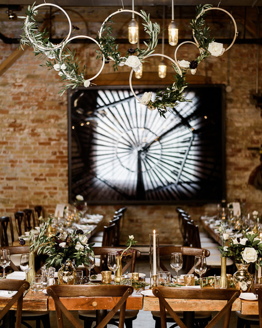 wood receptions tables with gold and glass place settings