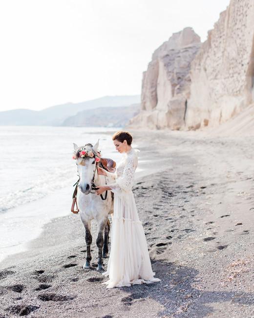 beach wedding dresses bride with horse on the beach