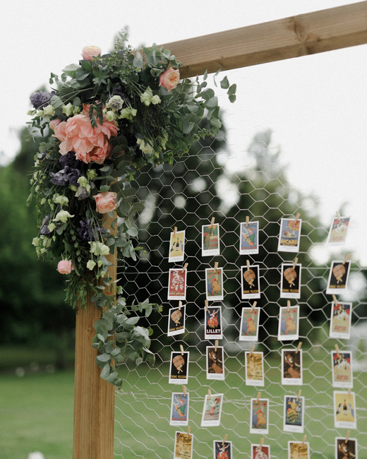 table cards on wooden framed metallic net