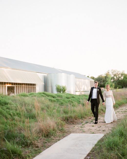 brittany peter wedding couple walking on pathway through grass