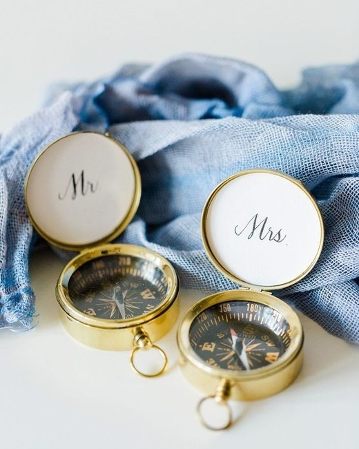 mr and mrs compasses sitting by blue cloth