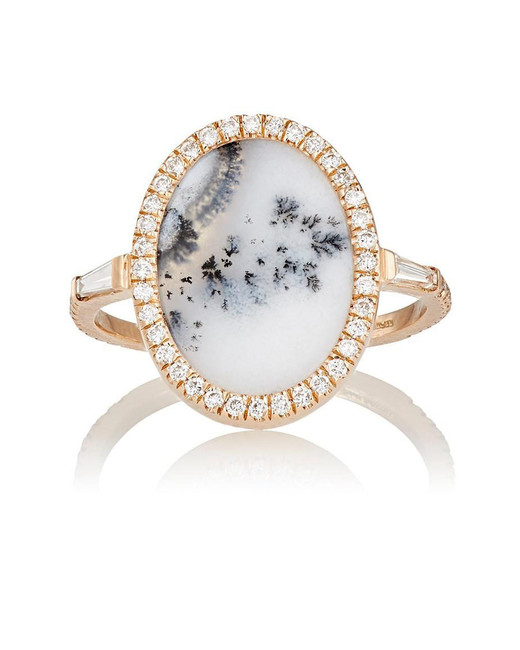 opal stone surrounded by diamonds engagement ring