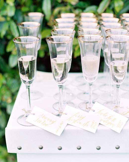 alcohol escort cards champagne glasses with tied cards