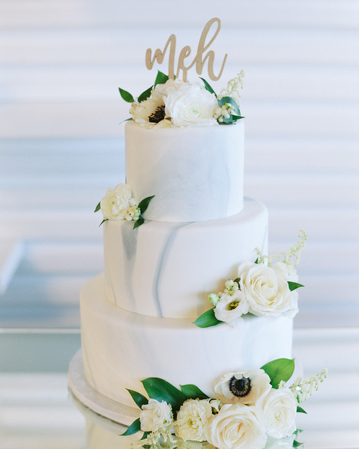 tiered wedding cake with white roses and meh topper