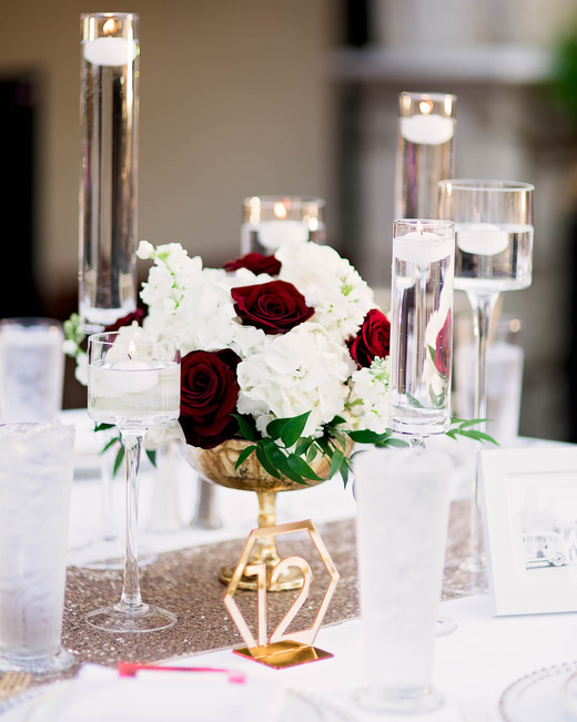 vibrant red and gold against white floral centerpieces