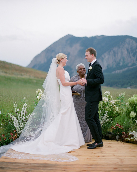 sloan scott wedding ceremony couple mountain backdrop
