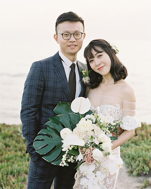 orchid, roses, and tropical leaf wedding bouquet
