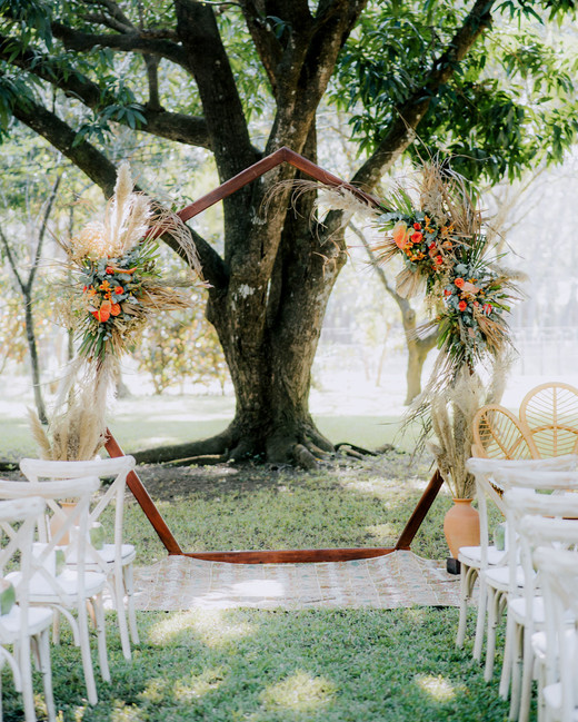 wooden backdrop with floral and greenery decor ceremony display
