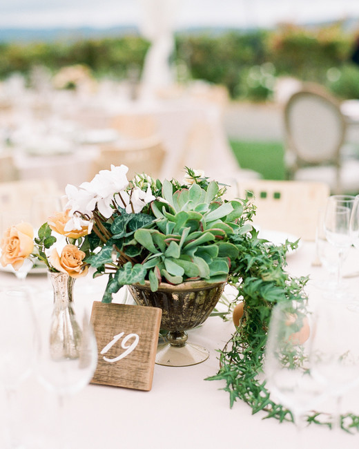 greenery plant reception table decor with golden lanterns and floral accents