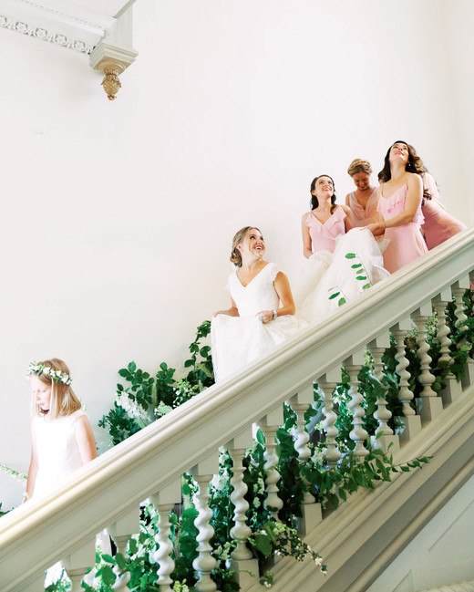sophie christopher wedding staircase with bride bridesmaids and flower girl