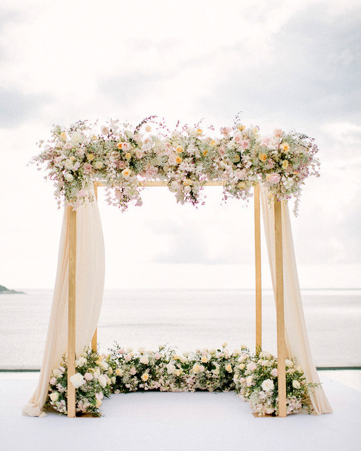 neutral ceremony arch with ethereal tulle