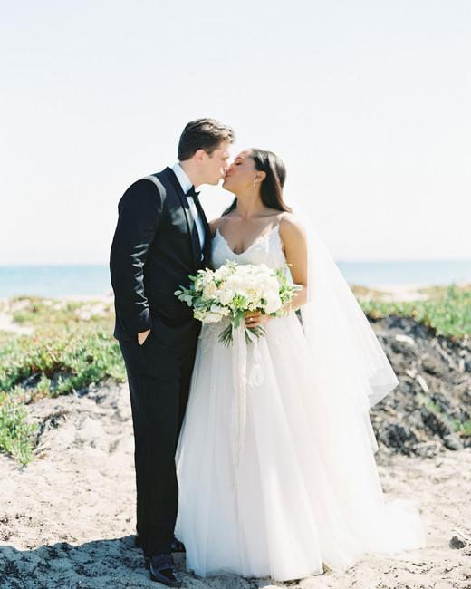 beach wedding dresses couple kissing on sandy walkway