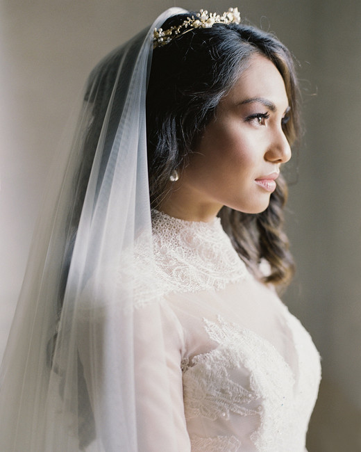 bride wearing veil, crown, and vintage pearl earrings