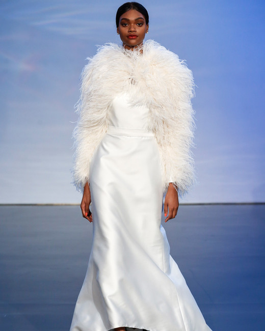 justin alexander signature fall 2019 high-low sheath with feathered jacket