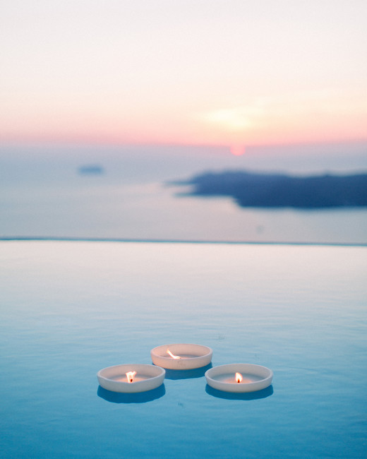 angie prayogo greece wedding candles pool