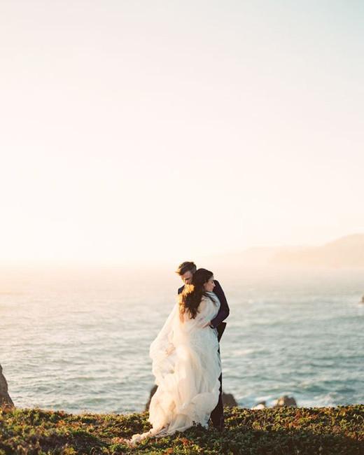 couple hugging beach