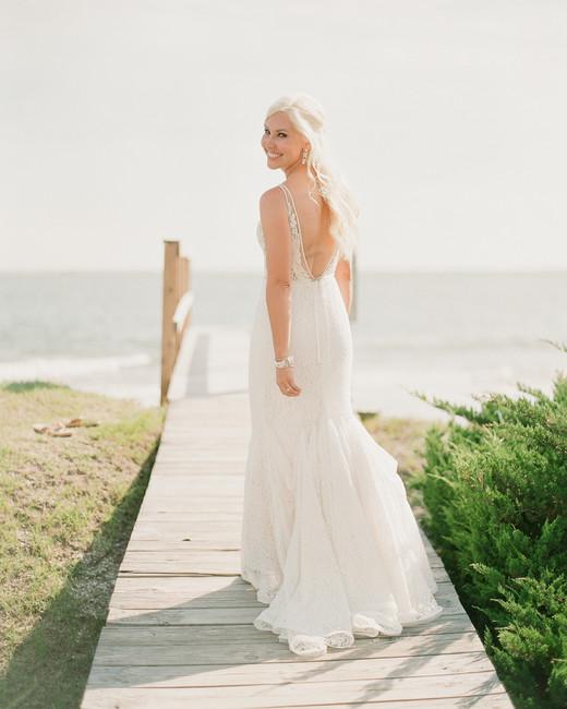 beach wedding dresses bride on boardwalk by the beach