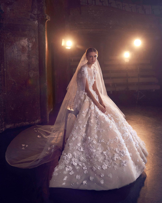 elie saab ball gown with floral embellishments wedding dress with sleeves fall 2018