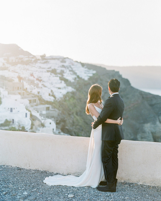 bride and groom overlooking greek coast