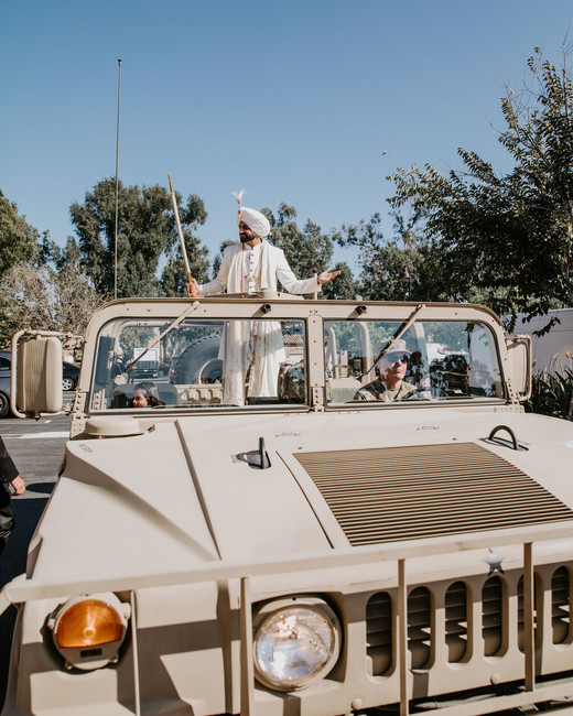 groom baraat ride in military vehicle