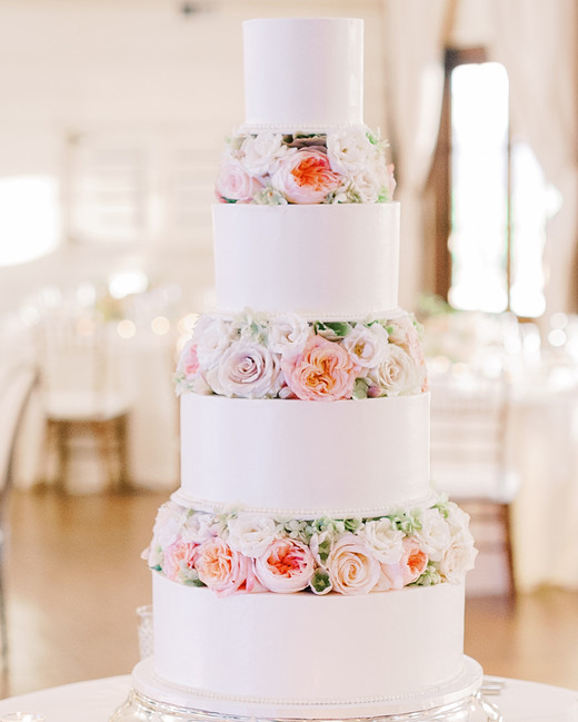 cakes with flora tiers on round table