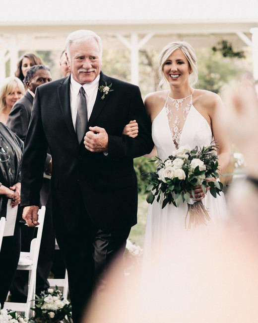 father of the bride wearing a black suit and charcoal gray tie