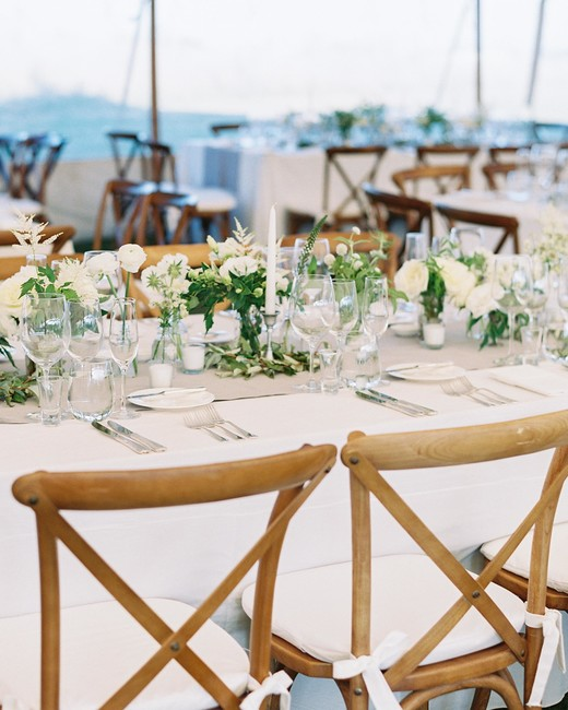 gray table runners under short vases, taper candles and votives