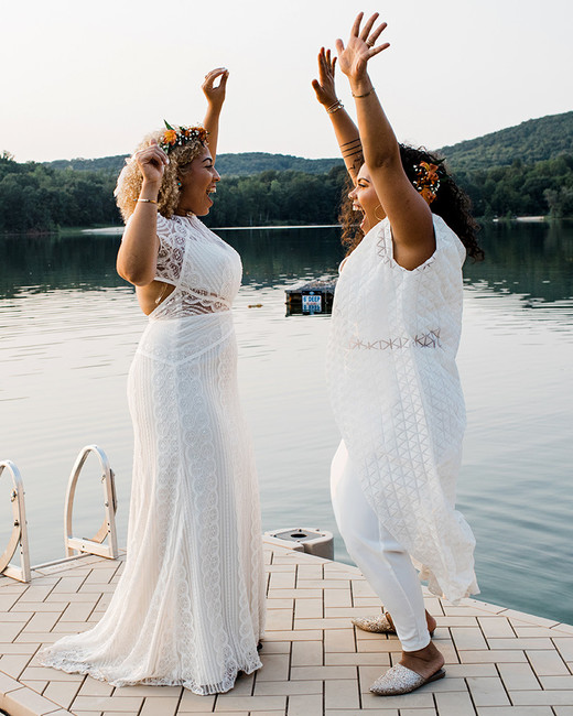 brides jumping on dock