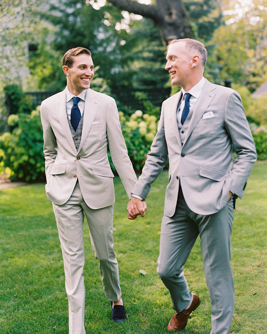 charles andrew wedding grooms holding hands