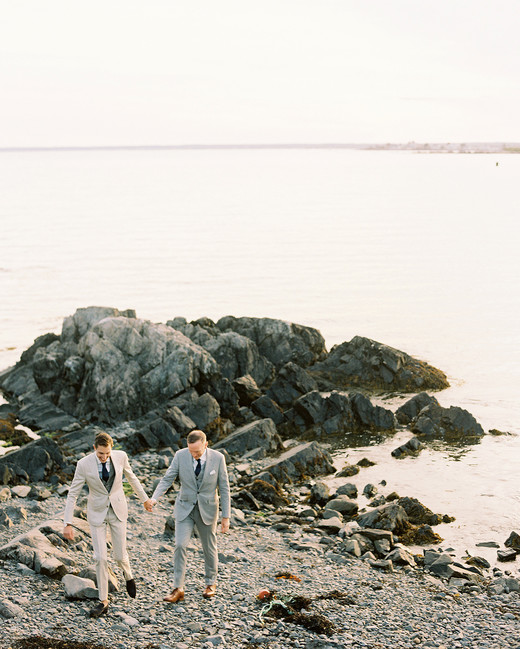 charles andrew wedding grooms on rocky shoreline