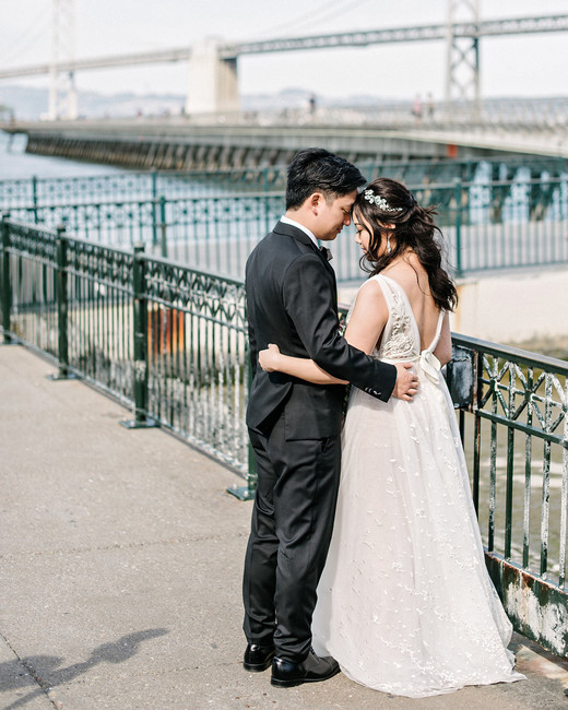 stephanie tim wedding couple overlooking bridge