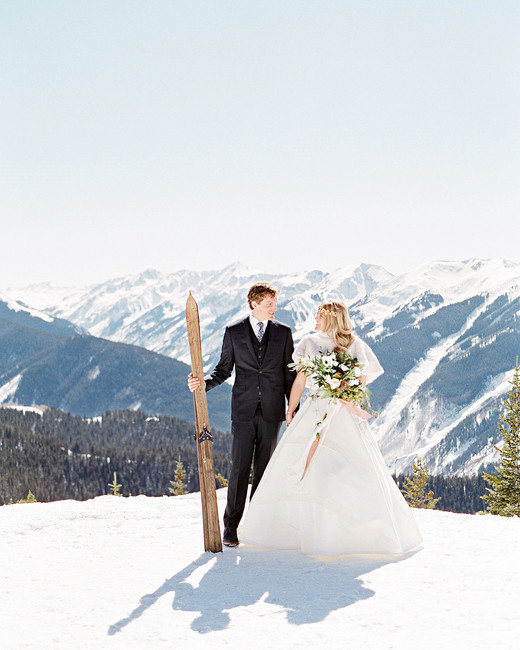 bride and groom portrait snow mountains