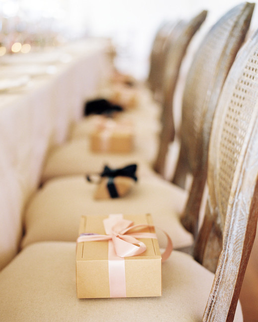 favor boxes on chairs