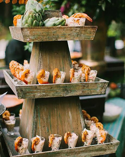 beach wedding ideas shrimp cocktails arranged on three tier tower