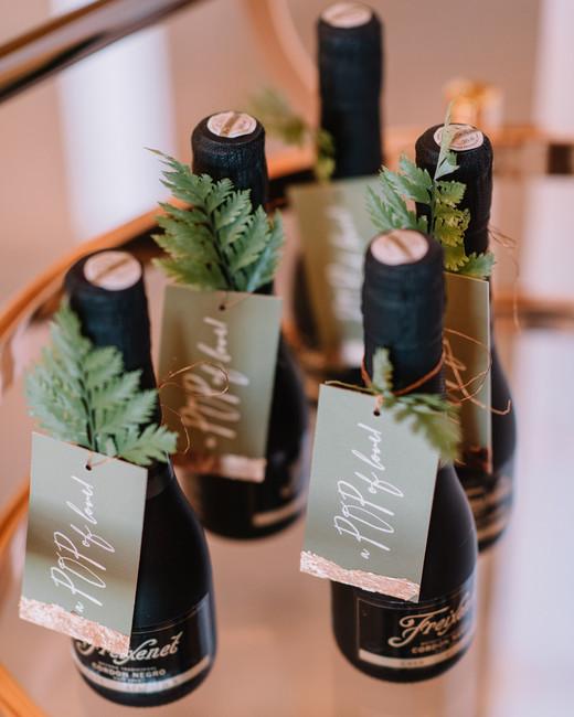 mini champagne bottle wedding favors with fern leaf name tag decor