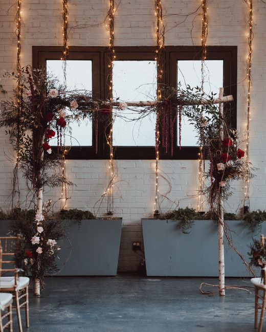 floral embellished arch and vines with string lights