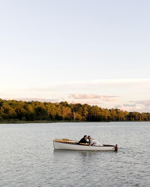 jen geoff wedding couple kiss in canoe