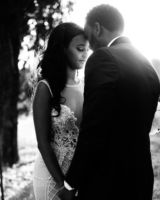veronica mickias wedding couple embracing candid