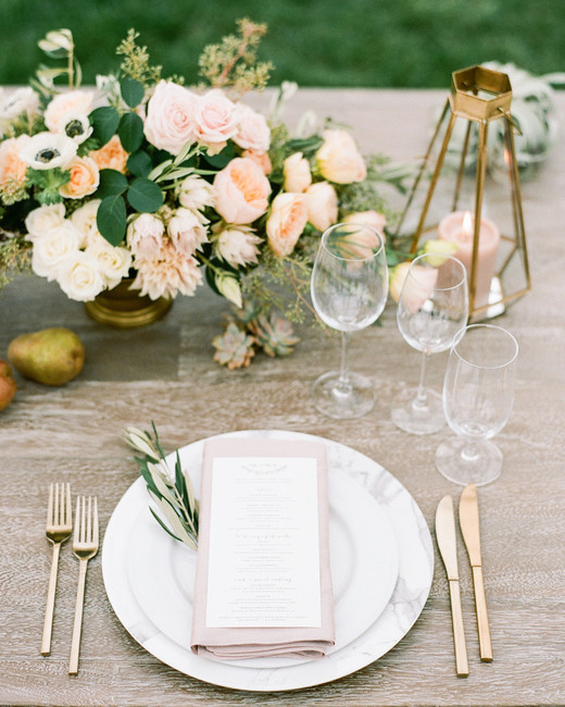white marble placesetting with gold and blush decor accents