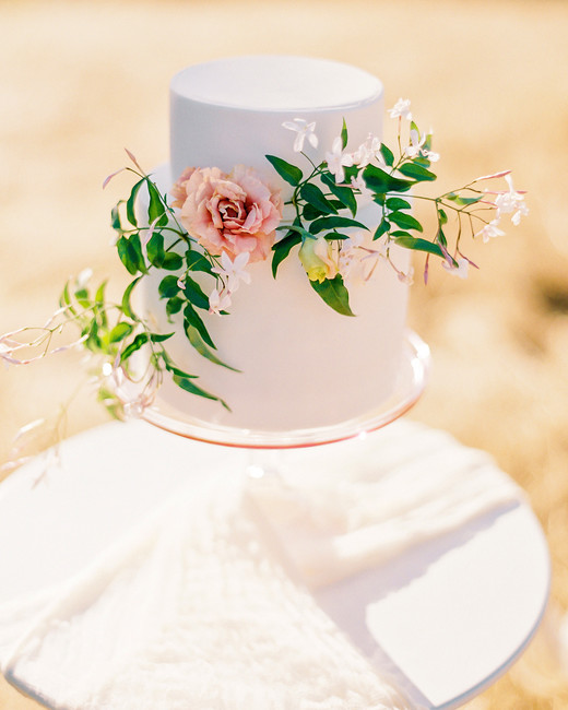 all-white two-tier floral accent cake