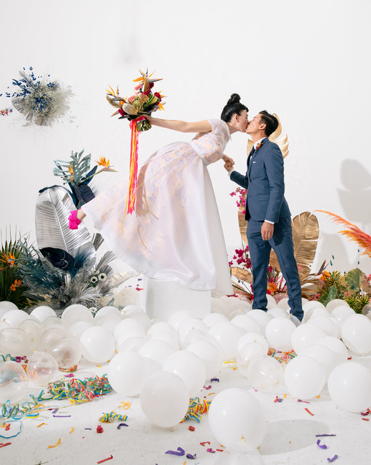tashina huy colorful wedding couple kiss