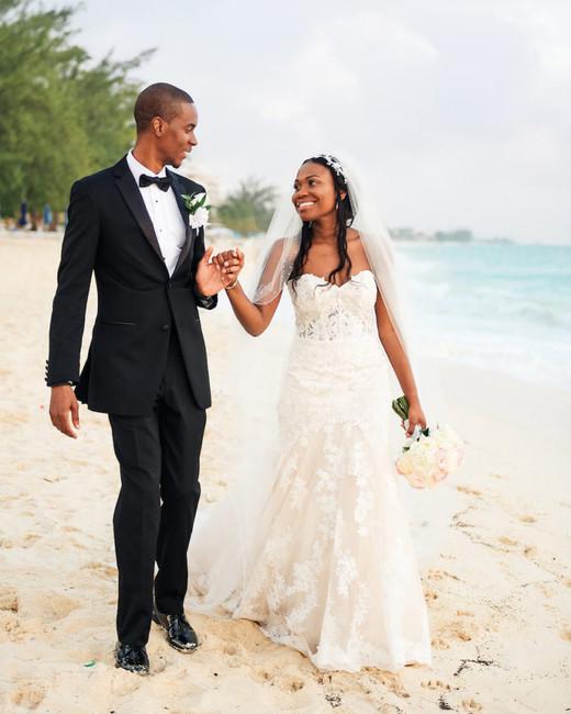 beach wedding dresses couple walking on beach